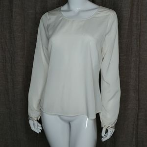 Cream blouse with golden metal accents